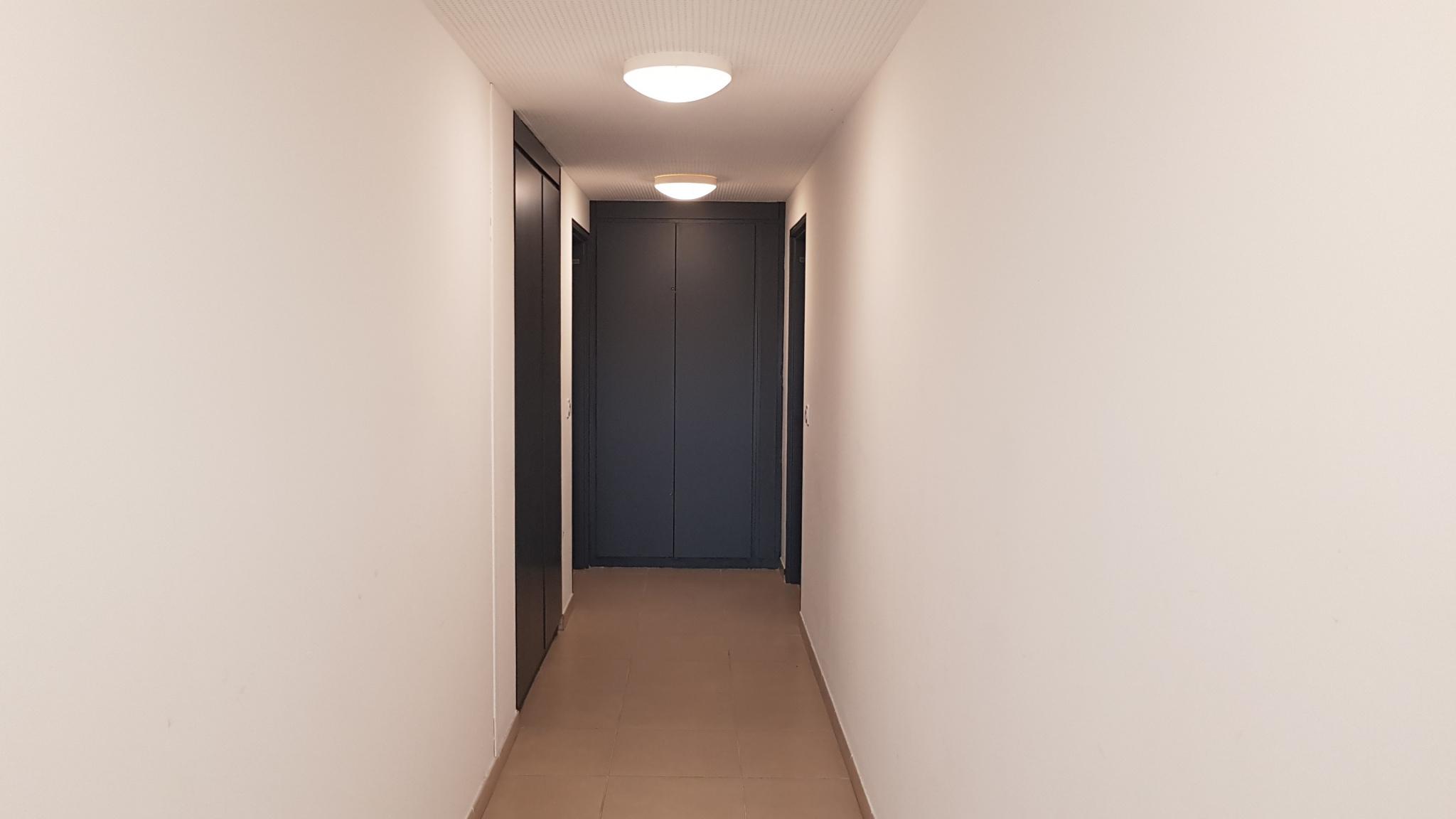 couloir accès des parties communes